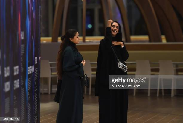 Saudi women are seen at a cinema theatre in Riyadh Park mall after its opening for the general public on April 30 2018 in the Saudi capital Saudi...