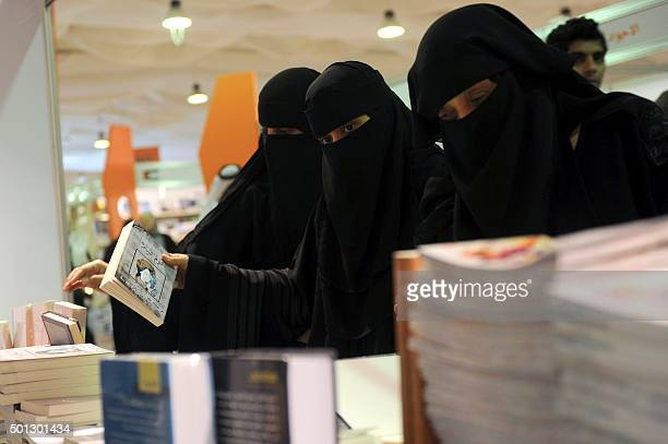 Saudi women attend the Jeddah International Book Fair on December 13 2015 in the Red Sea city of Jeddah AFP PHOTO / STR / AFP /