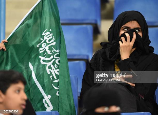 Saudi women cheer for their football team during a friendly match between Saudi Arabia and Iraq for the Superclassico championship at King Saud...