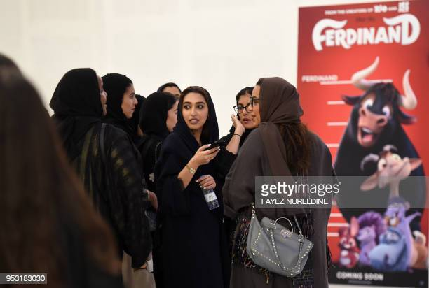 Saudi women gather at a cinema theatre in Riyadh Park mall after its opening for the general public on April 30 2018 in the Saudi capital Saudi...