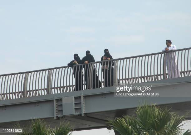 Saudi women in niqabs looking over a bridge, Mecca province, Jeddah, Saudi Arabia on December 14, 2018 in Jeddah, Saudi Arabia.