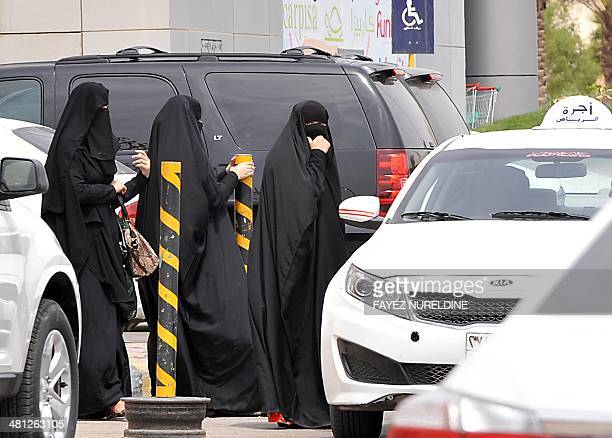 Saudi women leave a mall after ending her shopping in the capital Riyadh on March 29 2014 Saudi activists have urged women to defy a traditional...