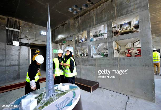 Saudi women look at model of Jeddah Tower ahead of a press conference on May 11 in the Red Sea city of Jeddah The completion date for the world's...