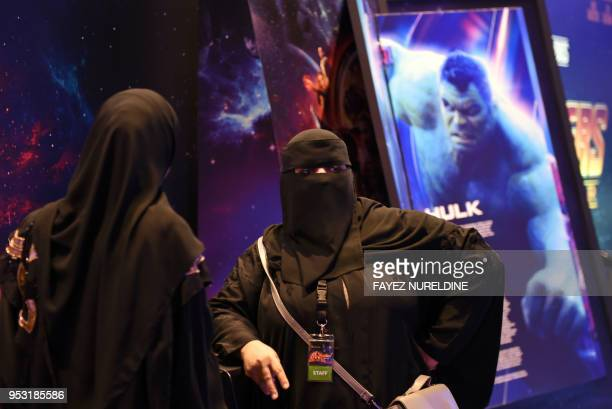 Saudi women members of staff talk at a cinema theatre in Riyadh Park mall after its opening for the general public on April 30 2018 in the Saudi...
