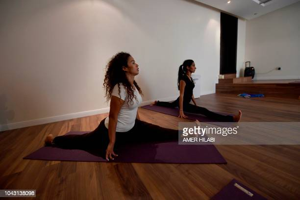 Saudi women practice yoga at a studio in the western Saudi Arabian city of Jeddah on September 7 2018 Widely perceived as a Hindu spiritual practice...