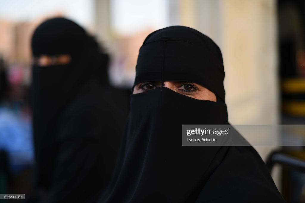 Saudi women sell homemade food in the Taiba Market on the