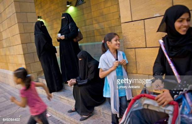 Saudi women sit outside of the mosque during evening prayer in Deira Riyadh Saudi Arabia June 10 2011 Saudi Arabia is governed by Sharia Law which is...