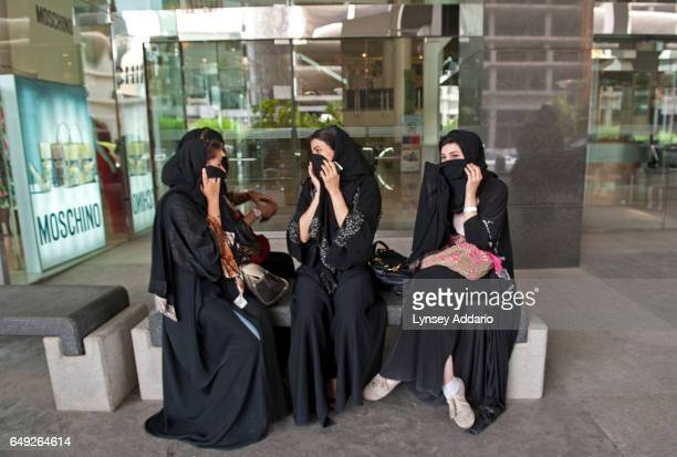 Saudi women sit outside the Kingdom Center in Riyadh Saudi Arabia June 10 2011 The Kingdom Center is one of the few places where Saudis gather to...