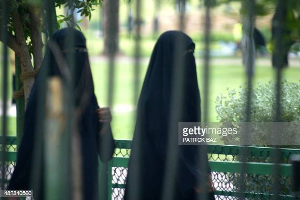 Saudi women take a walk in a fenced public park in Riyadh 14 July 2004. Saudi women's rights activists are still hoping women will have the vote in...