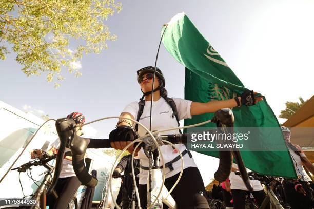 Saudi women take part in a cycling race to mark World Obesity Day celebration in Riyadh's Princess Nura University on October 11, 2019.