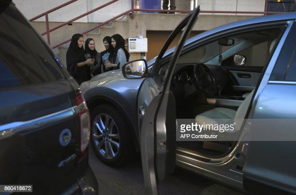 Saudi women take part in a training programme for new female drivers at Careem a chauffeur driven car booking service at their Saudi offices in...