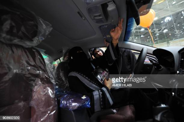 Saudi women tour a car showroom for women on January 11 in the Saudi Red Sea port city of Jeddah The showroom offers a wide selection of vehicles...