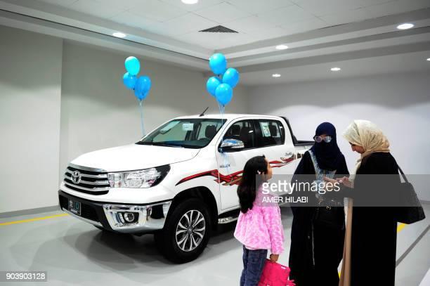 Saudi women tour a car showroom for women on January 11 in the Saudi Red Sea port city of Jeddah / AFP PHOTO / Amer HILABI