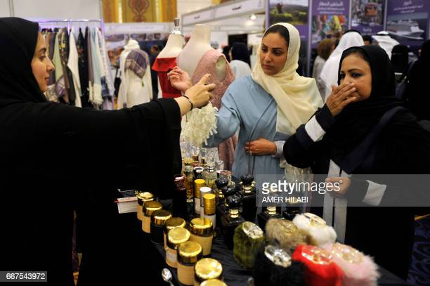 Saudi women try perfumes at a bridal expo on April 12 in the Red Sea city of Jeddah / AFP PHOTO / Amer HILABI