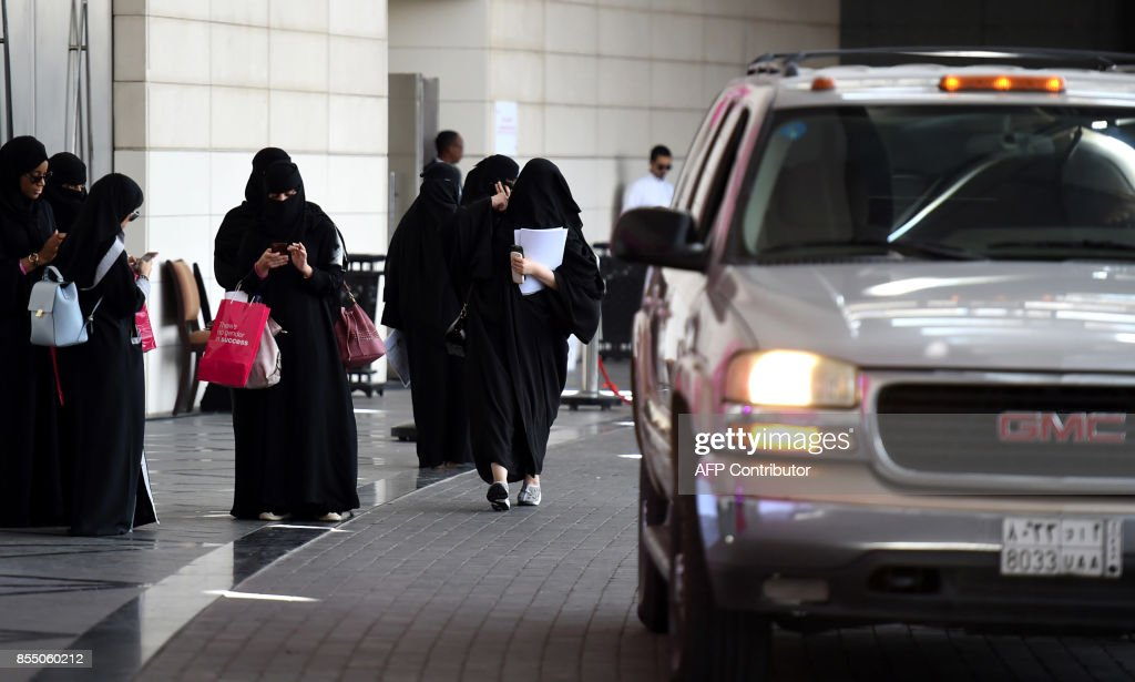 Saudi women wait for their drivers at a hotel in the Saudi capital Riyadh on September 28, 2017. Saudi Arabia will allow women to drive from June 2018, state media said on September 26, 2017 in a historic decision that makes the Gulf kingdom the last country in the world to permit women behind the wheel. The shock announcement comes after a years-long resistance from women's rights activists, some of whom were jailed for defying the ban on female driving. /