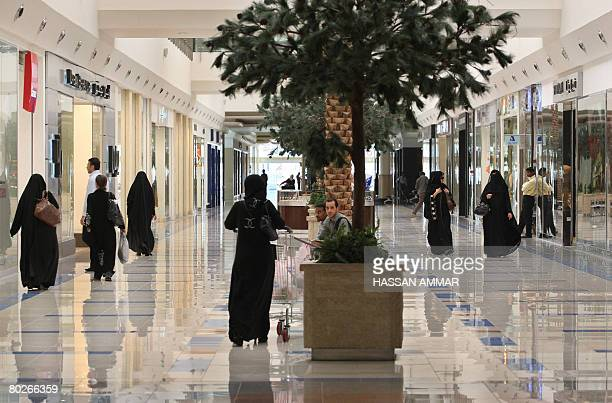 Saudi women walk at a shopping mall in the Saudi capital of Riyadh on March 16 2008 AFP PHOTO/HASSAN AMMAR