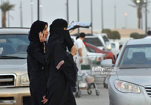 Saudi women walk outside a shopping mall in Riyadh on June 22 2012 Saudi female activists have cancelled their plan to brave a driving ban settling...