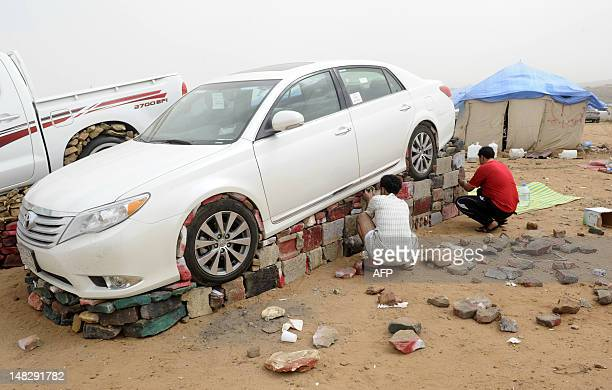 Saudi youths luift car with stones and bricks in the tourist area of alHabla 50km south of the city of Abha in the southern part of the kingdom on...