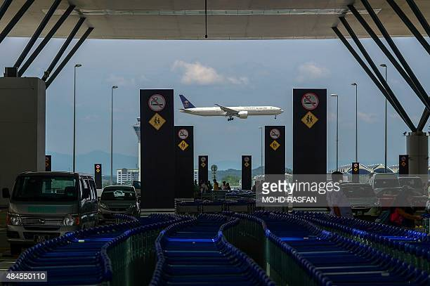 A Saudia Boeing 777 passenger aircraft makes its final approach for landing at the Kuala Lumpur International Airport in Sepang on August 20 2015...