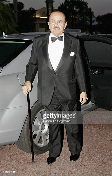 Saudiborn businessman Adnan Khashoggi arrives at the Monaco Red Cross Ball under the Presidency of HSH Prince Albert II in the Salles des Etoiles at...