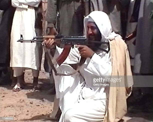 Saudiborn terrorist suspect Osama bin Laden is seen aiming a weapon in this undated photo from AlJazeera TV