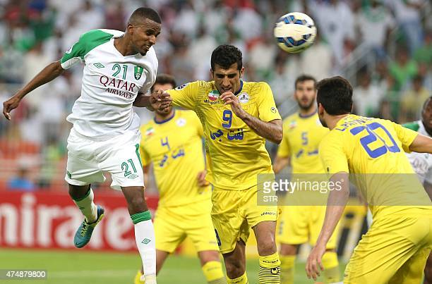 Saudi's Ageel Balghath fights for the ball with Iran's Naft Vahid Amiri during their AFC Champions League football match at the King Abdullah bin...