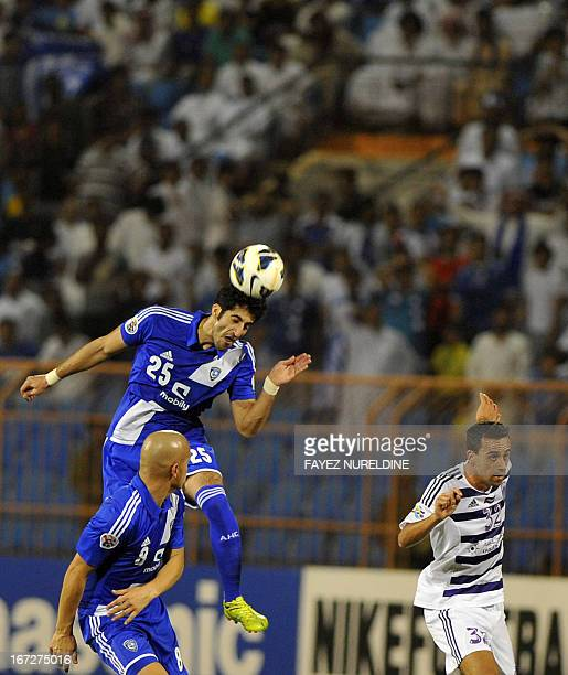 Saudi's Al-Hilal player Majed Al Marshadi heads the ball past UAE's Al-Ain player Alex Broxque during their AFC Champions League group D football...