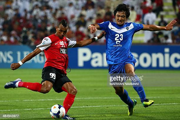 Saudi's Al-Hilal player player Kwak Tae-hwi fights for the ball against UAE's Al-Ahli Brazilian player Ciel during their AFC Champions League Group D...