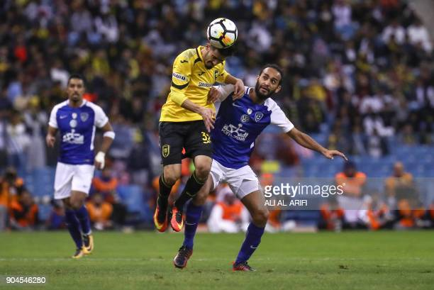 Saudi's AlHilal player vies for the ball against AlIttihad's Omar alMezeaal in the Saudi Pro League football match at the King Fahd International...