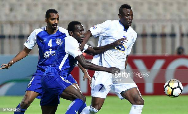 Saudi's alHilal players Abdulmalek Al Khaibri and Abdullah alZoari vie for the ball against Iran's Esteqlal club player Mame Baba Thiam during the...