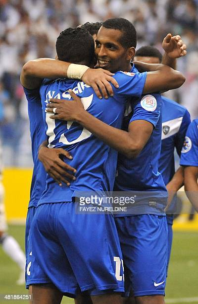Saudi's Al-Hilal players celebrate after scoring a second goal against Qatar's Al-Sadd team during their AFC Champions League group D football match...