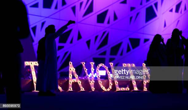 Saudis arrive to attend a panel discussion with US actor John Travolta at the Apex Convention Center in the capital Riyadh on December 15 2017...