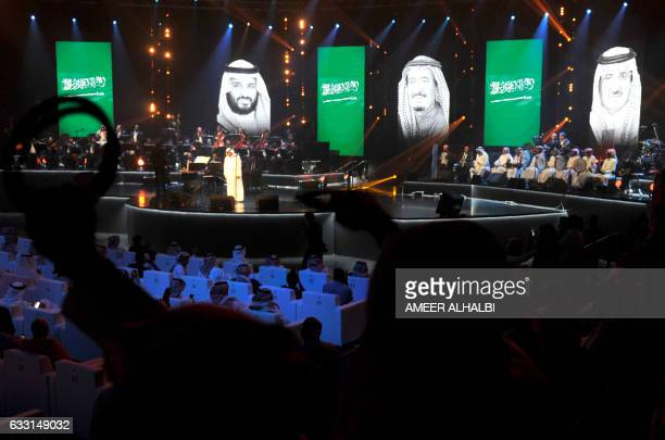 CORRECTION Saudis attend a concert in Jeddah on January 30 2017 Saudi Arabia's 'Paul McCartney' took to the stage as the kingdom seeks to boost...