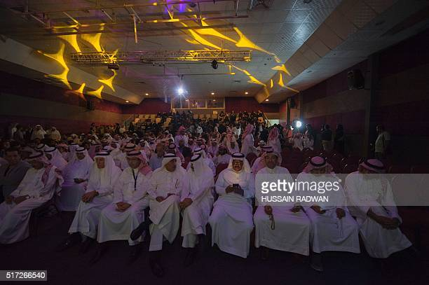 Saudis attend the opening ceremony of the film festival on March 24, 2016 at the Saudi Cultural Center in Dammam, some 400 km eastern of the capital...