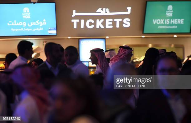 Saudis gather at a cinema theatre in Riyadh Park mall after its opening for the general public on April 30 2018 in the Saudi capital Saudi Arabia...