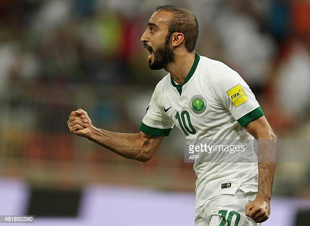 Saudi's Mohammed AlSahlawi celebrates his teams goal during the AFC qualifying football match for the 2018 FIFA World Cup between Saudi Arabia and...