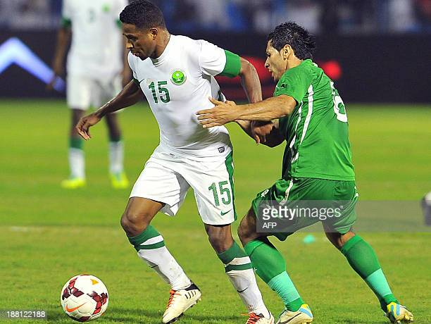 Saudi's Nasser alShamrani vies with Iraqi's defender Ali Adnan during an Asian Cup 2015's qualifier between Saudi and Iraqi at Prince Mohammed bin...