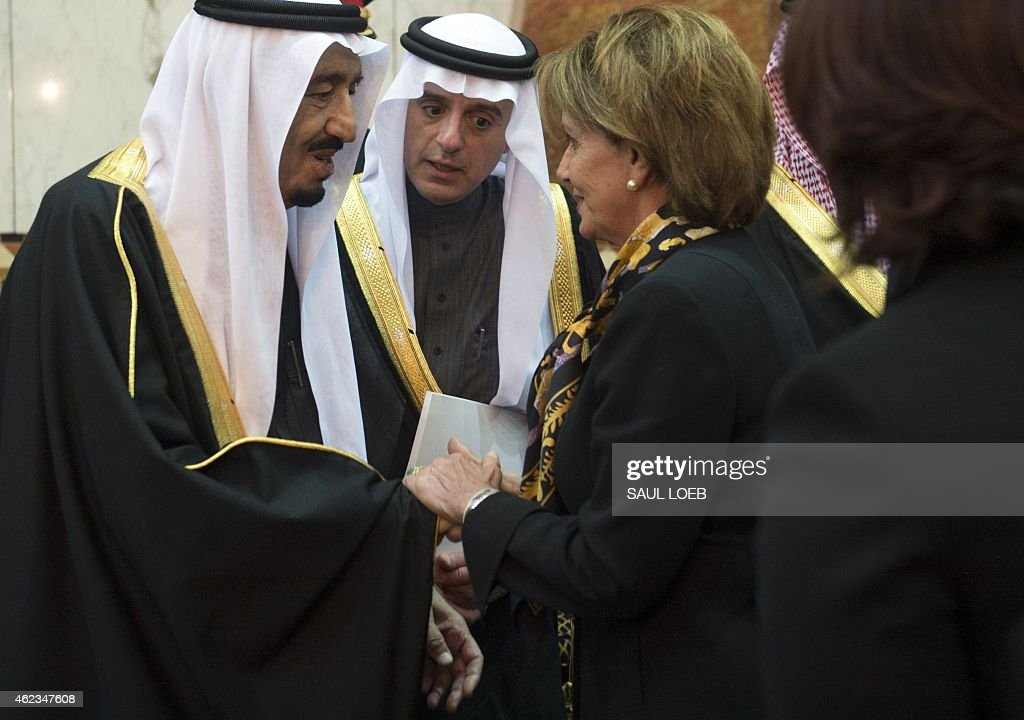Saudi's newly appointed King Salman (L) shakes hands with US House Minority Leader Nancy Pelosi (C) at Erga Palace in Riyadh on January 27, 2015. Obama landed in Saudi Arabia with his wife First Lady Michelle Obama to shore up ties with King Salman and offer condolences after the death of his predecessor Abdullah.