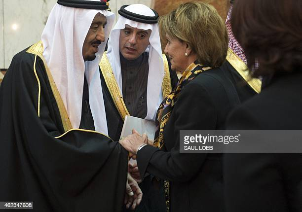 Saudi's newly appointed King Salman shakes hands with US House Minority Leader Nancy Pelosi at Erga Palace in Riyadh on January 27 2015 Obama landed...
