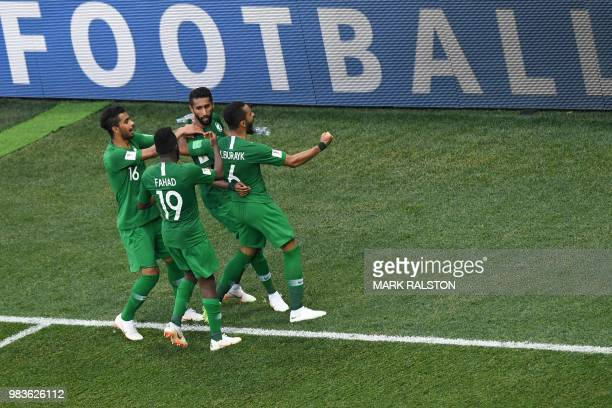 TOPSHOT Saudi's players celebrate their equaliser during the Russia 2018 World Cup Group A football match between Saudi Arabia and Egypt at the...