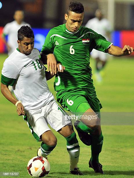 Saudi's Salem alDawsari vies for the ball against Iraq's defender Ali Adnan during their 2015 Asian Cup group C qualifying football match at Prince...