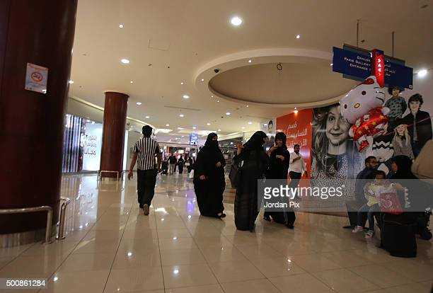 Saudis shop at the Red Sea Mall one of the biggest malls in city on December 10 2015 in Jeddah Saudi Arabia