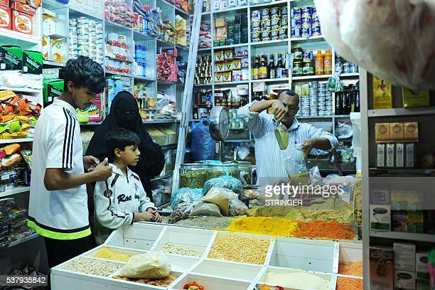 Saudis shop for spices at a market in the city of Jeddah on June 3 as the faithful prepare for the start of the holy fasting month of Ramadan More...