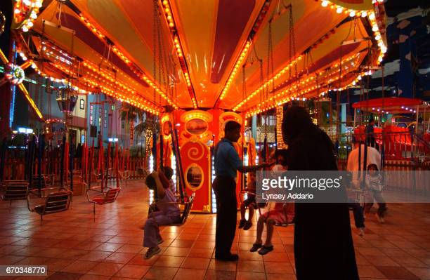 Saudis spend time at an indoor amusement park in the Fouad Center in Dammam Saudi Arabia October 2003