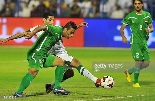 Saudi's Taiseer alJassam shoots the ball against Iraq's defender Ali Adnan during their 2015 Asian Cup group C qualifying football match at Prince...