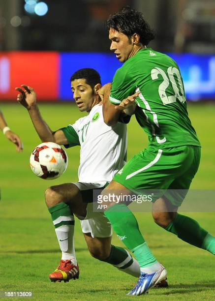 Saudi's Taiseer alJassam vies for the ball against Iraq's defender Muthana Khalid during their 2015 Asian Cup group C qualifying football match at...