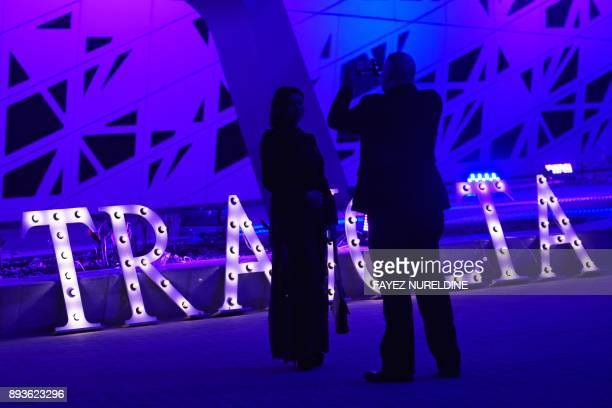 Saudis take a picture outside the Apex Convention Center as they arrive to attend a panel discussion with US actor John Travolta in the capital on...