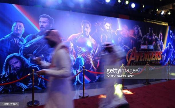 Saudis walk at a cinema theatre in Riyadh Park mall after its opening for the general public on April 30 2018 in the Saudi capital Saudi Arabia...