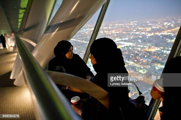 Saudis watch Riyadh from the sky bridge of the Kingdom Center in Riyadh Saudi Arabia June 9 2011 The Kingdom Center is Saudi Arabia's tallest point...