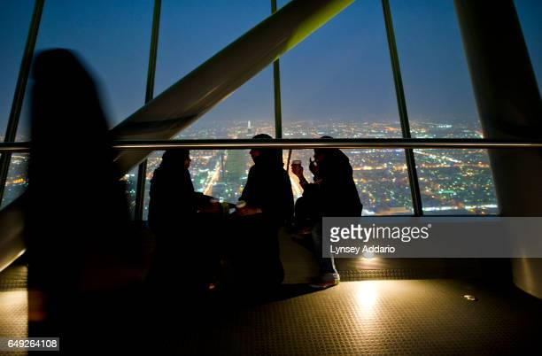 Saudis watch Riyadh from the sky bridge of the Kingdom Center in Riyadh Saudi Arabia June 9 2011 The Kingdom Center is Saudi Arabia's tallest point...